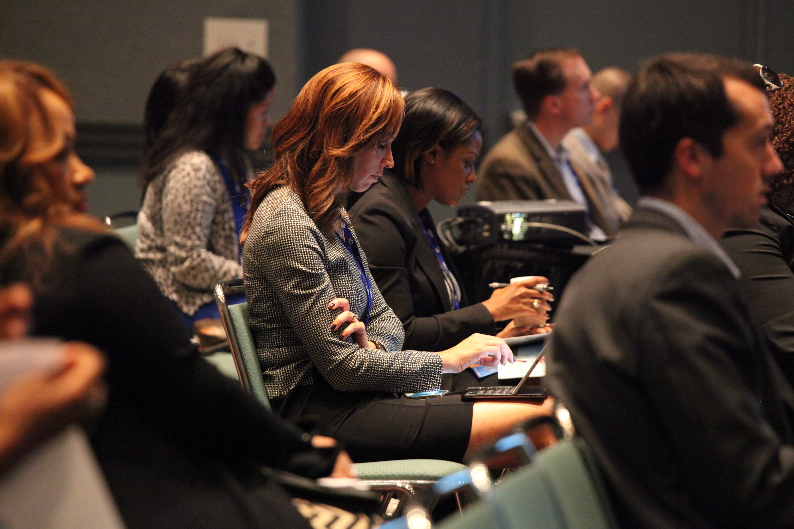 Conference attendees taking notes on the RFP process during the Tuesday morning workshop.
