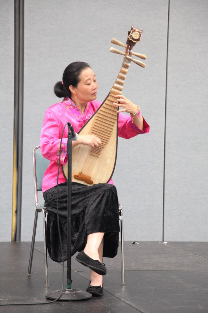 A musician plays her lute, a Chinese instrument, at Wednesday's NMSDC Networking Continental Breakfast.