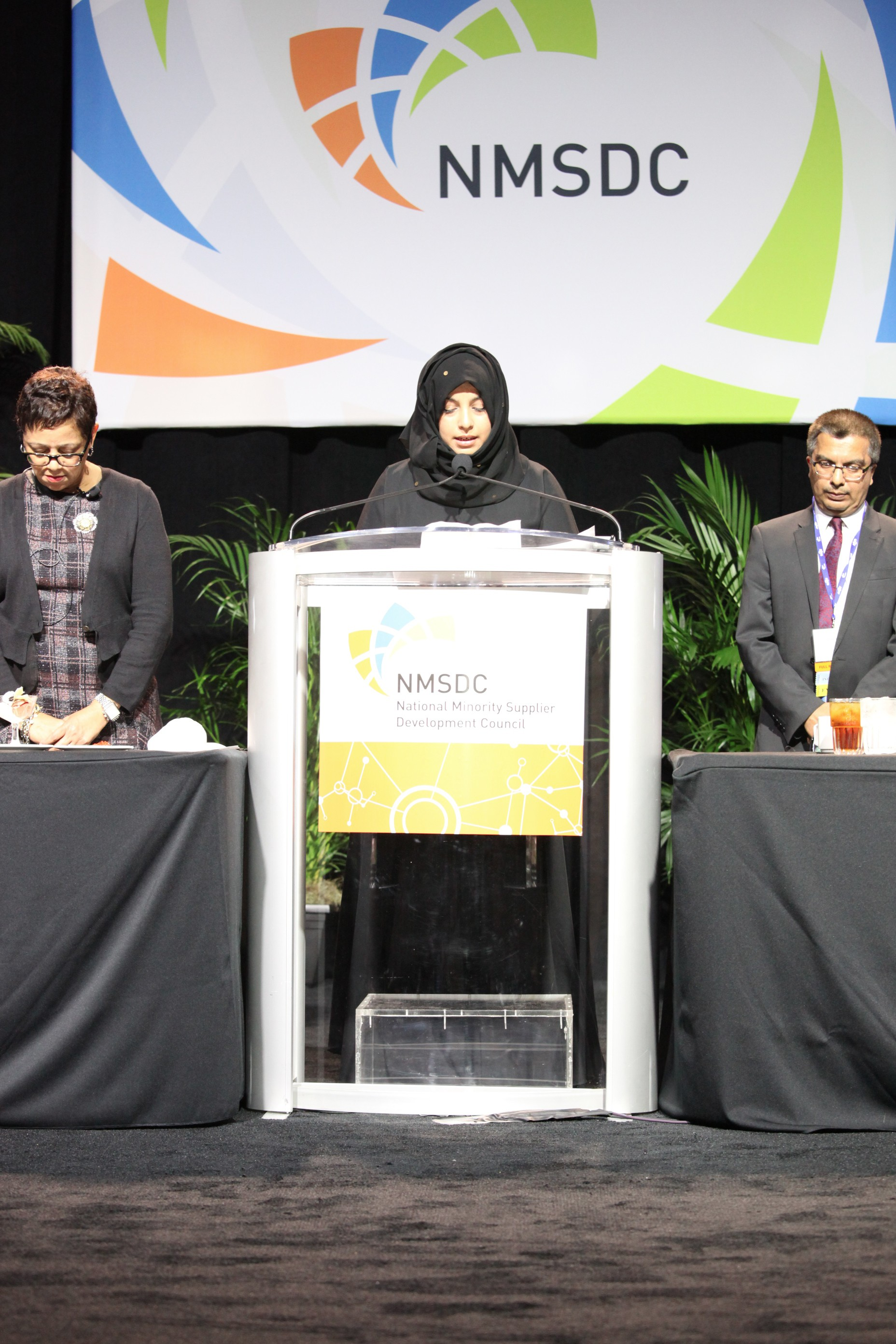 Azra Khalfan delivers the invocation at Tuesday's International Luncheon.