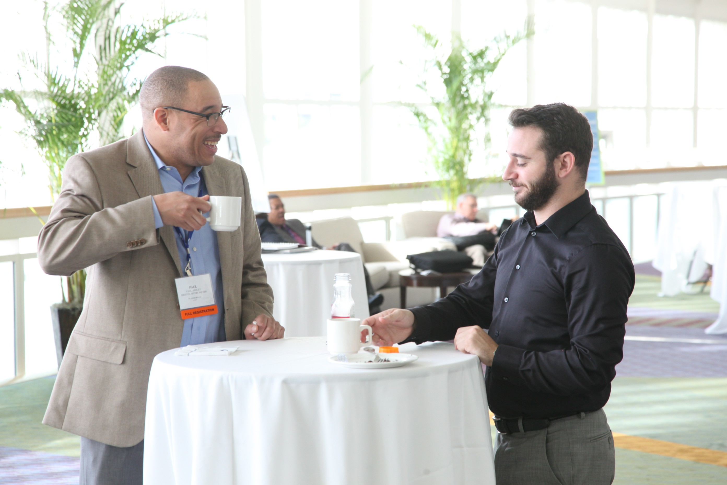 NMSDC attendees share a laugh over coffee during Wednesday's Networking Continental Breakfast.