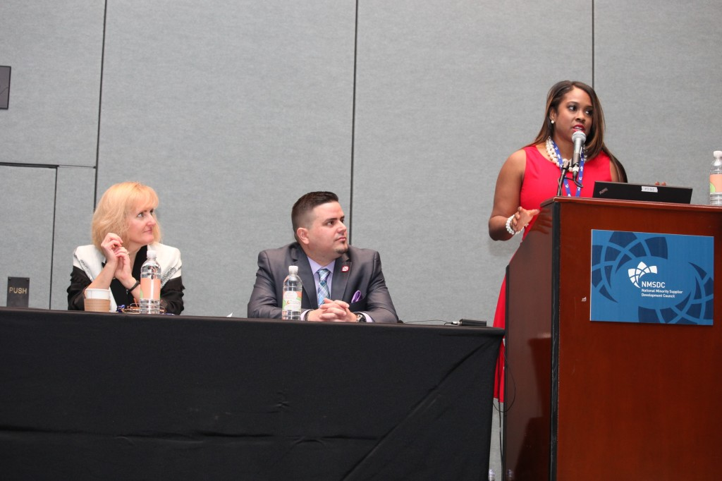 Karmetria Dunham Burton of Delta Air Lines (far right), Raul Suarez-Rodriquez of CVS Health (center) and Teresa LeFevre of Comerica Bank talk to conference attendees about the importance of building internal and external committees to advance supplier diversity within their organizations.